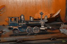 Antique Toy Train Still Life with Feathers - photograph by Douglas MooreZart.  #douglasmoorezart #sets #toytrain