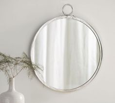 """Logan Round Mirror - $149 Overall (without top ring): 22.5"""" diameter, 0.75"""" deep"""
