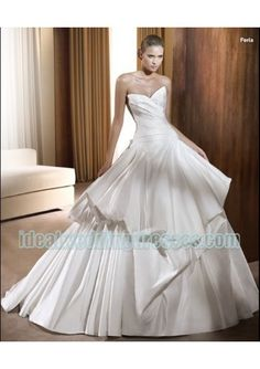 Basic Description: This brand new custom made fashion taffeta 2011 wedding dress features its strapless v neck with rouched bodice and asymmetrical pick up a line skirt and chapel train. This modern wedding dress can also be used for spring wedding d modelgelin.com