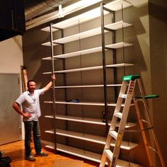 Just finished and installed this rather large library/display bookshelf for Philadelphia based book/graphic/web/amazing designer Paul Kepple of @headcasedesign ... Phase two involves a rolling ladder in same style :) #handmade #madeinphilly #modernfurniture #coldrendesign #customfurniture #heavy #bookshelf #library #steelfurniture #woodandsteel #interiordesign #welded #longassday @_jackie_paper_  with help from Josh Dowel ;)