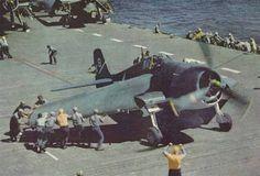 Flight deck crew of USS Yorktown extending the wing of a Hellcat fighter, Oct 1943-Apr 1944