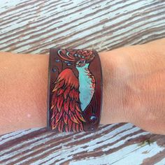 Commisioned cuff- Phoenix Pyrography, Hand Dyed and Hand Painted.