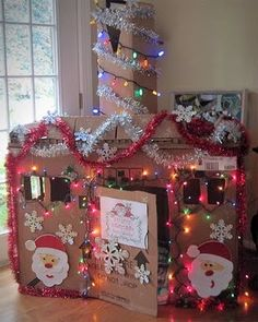 BEST IDEA EVER!!  Make a cardboard house and let kids decorate their own house for Christmas!!