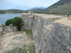 The limestone walls of the Castle of Ali Pasha Tepelena at Porto Palermo, Albania, are up to meters thick. At each corner of the triangular fort are pentagonal towers. Limestone Wall, Albania, Palermo, Towers, Ali, Coastal, Porto, Seaside, Lineman