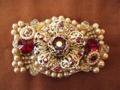 Vintage rhinestones and bits of jewelry were salvaged to make this one of a kind belt buckle. RetroRosiesVintage on Etsy.