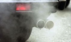 Emissions come out of a car exhaust