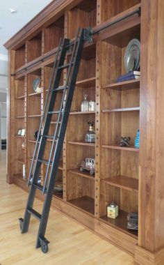Vintage Black Library Ladder With Wooden Book Storage Set On Wooden Flooring