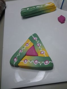 Step 9. Assemble in triangle around a smaller triangle. Reduce.