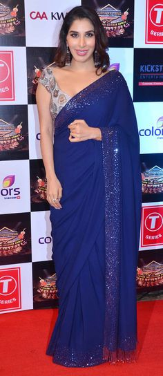 Indigo blue sari with a grey sequinned blouse. Sophie Choudry at a Gulshan Kumar tribute concert.