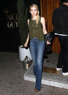 Flared jeans are making a comeback! Emma Roberts showed how to rock the trend. The actress picked a pair of J brand jeans, a dark green tank and leopard pumps while out in Los Angeles on June 11, 2015.