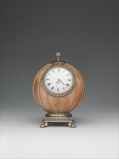Spherical Clock House of Carl Fabergé Date: before 1899 Medium: Rose jasper, silver, silver gilt, gold, enamel, glass