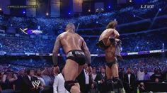 GIF of Batista & Randy Orton's RKO Bomb on Daniel Bryan at WrestleMania XXX | Daily Wrestling NewsDaily Wrestling News