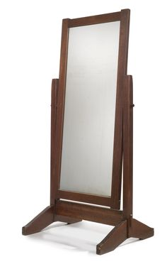 Gustav Stickley,  CHEVAL GLASS, MODEL NO. 35. oak, wrought-iron hardware and with the original mirrored glass,circa 1902, executed by the Craftsman Workshops of Gustav Stickley, Eastwood, NY.