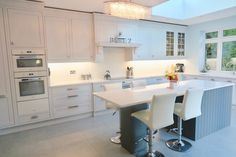White appliances with a grey kitchen gives a clean fresh look