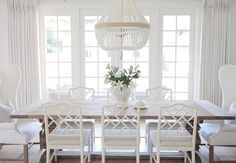 white coastal dining room design, white cottage dining room decor with white wood dining room chairs and bead chandelier, upholstered wingback dining room chairs, neutral dining room Dining Room Walls, Dining Room Design, White Dining Rooms, White Dining Chairs, Dining Tables, Side Tables, Chippendale Chairs, Coastal Living Rooms, Coastal Entryway