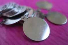 15 PCS (14 mm) Nickel Plated Brass Tag for Cabochon-Finding-AP-79M. $4 with shipping, via Etsy.