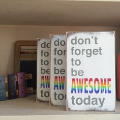 "Limited edition small size Don't Forget To Be Awesome Today hand painted sign.   Weather worn white with grey and rainbow letters.      9"" X 5.5"" X .75""    sign will ship in two-three  weeks.  