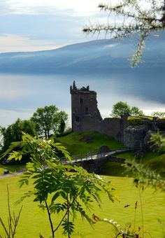 Urquhart Castle sits beside Loch Ness in Highlands, Scotland Beautiful Castles, Beautiful Places, The Places Youll Go, Places To See, Voyager C'est Vivre, Lago Ness, England And Scotland, Scotland Uk, Scotland Castles