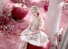 got a bit obsessed with this nina ricci perfume ad - love the dress and hair. one question though... are these big apples or is it a tiny lady? ;-)