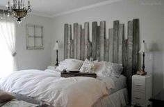 reclaimed wood headboard - not doing a nautical theme, but since we have that big beach print a naturistic beach theme feels appropriate - although how silver plays into that I have no idea