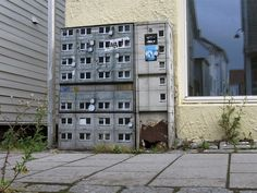 Artist Paints Miniature Apartment Buildings around the City - Artwork by Evol