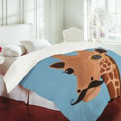 This is super hipstery, but I kind of love it.  Gentleman Giraffe duvet cover.