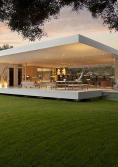 casas-minimalistas-moderna-paredes-de-vidrio-muebles-de-metal-color-blanco