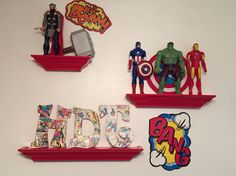 Avengers Theme Toddler Bedroom ~ The floating shelves and the letters came from… Comic Themed Room, Comic Room, Marvel Nursery, Marvel Bedroom, Floating Wall, Floating Shelves, Small Game Rooms, Avengers Room, Superhero Room