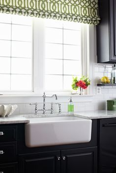 farmhouse sink is a must when we do a kitchen reno + remove top wood panel over sink and add colorful shade and wide blinds. easy way to brigthen up kitchen.