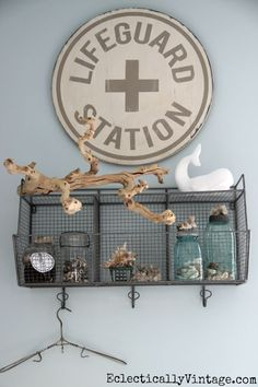 Love this Lifeguard Station sign in the bathroom and all of her coastal accessories eclecticallyvintage.com