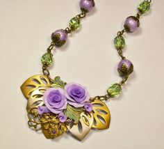 Spring Challenge 4-30-16 from Novegatti Designs:   Polymer clay roses with B'Sue brass, spectra and czech glass beads. www.facebook.com/NovegattiDesigns