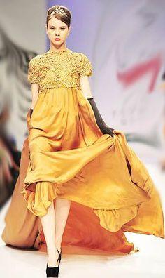 Golden Dress With Black Heels. Leo and Libra.