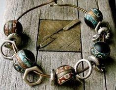 Bracelet by Lorelei Eurto: brass with polymer clay beads by Pam Wynn