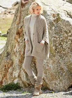 A profusion of cables, twists and ribs patterns our cozy, poncho-style cardigan. Knit in a cloud-soft blend of Latte baby alpaca (70%), nylon (23%) and merino wool (7%), this luxurious embrace of a sweater is easy atop skinny jeans or leggings, with drop shoulders, tacked ¾-sleeves, patch pockets and side vents.