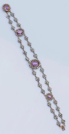 An antique gold, seed pearl and purple stone bracelet, 19th century.