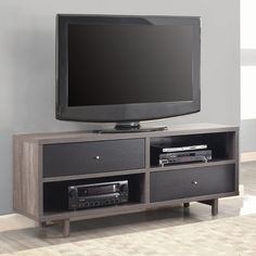 Coaster Furniture TV Stand with 2 Drawers. Solid wood construction with veneers. Black and weathered gray finish. 2 Drawers and 2 Open shelves. Maximum TV Size: 66 in. Clean, simple styling.