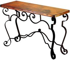 The Libby sofa table has a classic Southwest look with its elaborate iron work along the sides and corners of the base. The copper table top is available in two sizes and will work in an entryway or living room.  Similar pieces are available below under 'We Also Suggest'.
