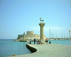 Wonders of the Ancient World - Colossus of Rhodes.The Colossus of Rhodes was a statue of the the Sun Greek god Helios, on the Greek island. Wonderful Places, Beautiful Places, Beautiful People, Places To Travel, Places To Visit, Greece Rhodes, Luxury Boat, Medieval Town, Greek Islands