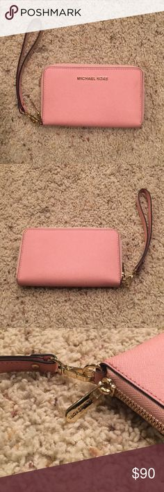NWOT Perfect Michael Kors Jet Set Wristlet NWOT Only used once. Same color as the cross body in my closet. Bundle both for a great discount.  Perfect condition!! Removable wrist strap to make it either a clutch or a wallet! Such a beautiful pink color! Cross stitch detail on the fabric. Michael Kors Bags Clutches & Wristlets