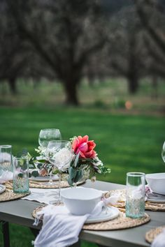 Flowers on table with table settings