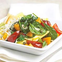 Tricolor Tomato Ravioli Almost too pretty to eat, this colorful pasta main recipe combines ravioli, tomatoes, spinach, and Parmesan cheese into one delicious main dish.