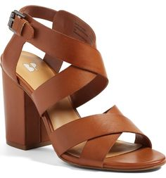 Crisscrossing straps make this block-heel sandal a trend-savvy yet supremely versatile choice for any occasion.