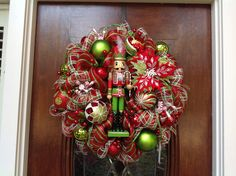 Nutcracker Holding Candy Cane Wreath by HertasWreaths on Etsy