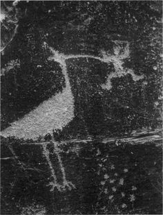NATIVE AMERICAN PETROGLYPH, CIRCA 1000 A.D. GIANT BIRD HOLDING A MAN IN ITS BEAK. PUERCO VILLAGE, PETRIFIED FOREST NATIONAL PARK, AZ.