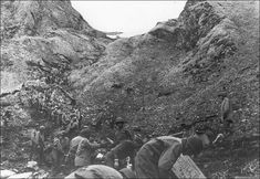 American troops sending supplies to the front lines during the battle for Attu Island, May 1943. Even where the terrain was flat, the soggy tundra could not support heavy vehicles.