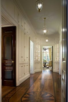 Wow, the floor, cabinets, doors, curve of the hall. All is gorgeous and amazing