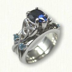 14kt White Gold Vanessa Reverse Cradle set with a 6 x 4 pear shaped chatham sapphire with side topaz round stones