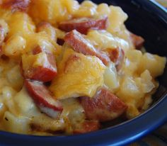"Cheese Potato & Sausage Casserole-3 C potatoes, peeled, boiled & diced; 4 T butter; 4 T flour; 2 C milk; 1/2  tsp salt; ¼ tsp pepper; ½ lb Velveeta, diced; ½ C Cheddar Cheese shredded; 1 lb sausage;1/8 tsp paprika Cut sausage in 1/2 lengthwise & chop into 1/2 in ""half moons"". Cook in frying pan 15 min. Put diced potatoes in 2 qt dish. Add meat  Mix remaining ingredients in saucepan Pour cheese sauce over potatoes & meat. Add cheddar cheese & paprika over top. Bake 350°F 35-45 min"