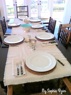 Learn to make a drop cloth table runner that looks just like linen. The drop cloth material that painters use is great fabric to make a table runner out of.