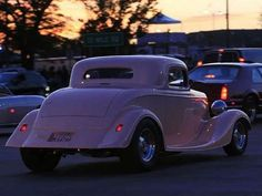 Cars cruise in the evening during the Woodward Dream Cruise Saturday Aug. 15, 2012.  MANDI WRIGHT/Detroit Free Press